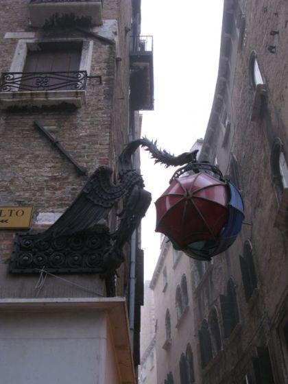 Bird with Umbrella Sign