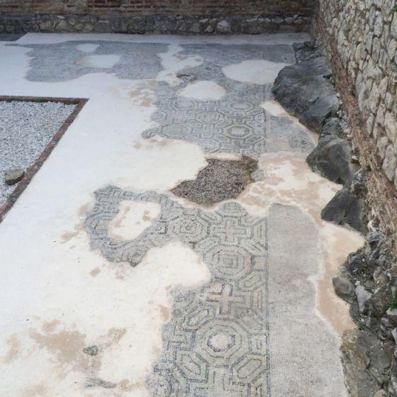 Split mosaics in sidewalk
