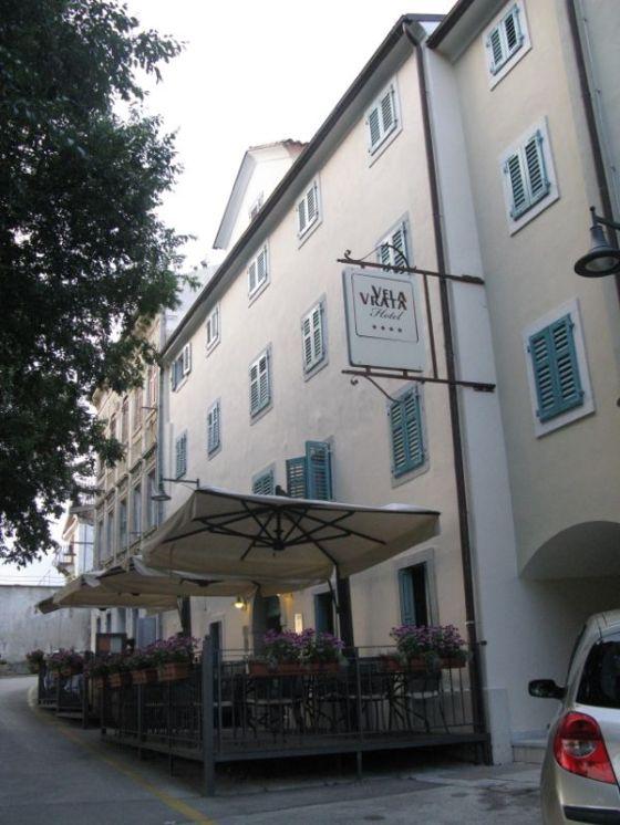 Vela Vrata Hotel with sign