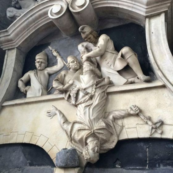 church statue falling cleric