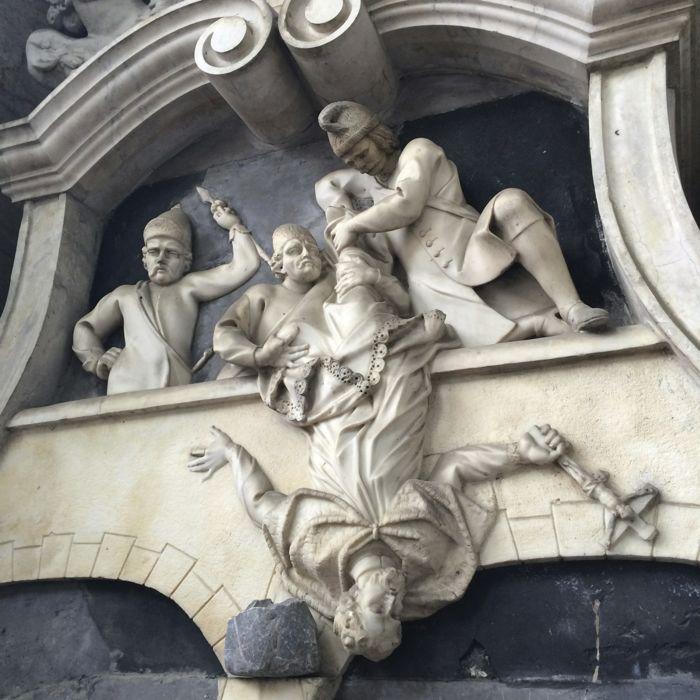 church statue falling cleric
